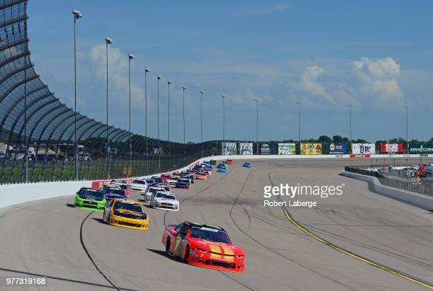 Justin Allgaier driver of the BRANDT Professional Agriculture Chevrolet leads a pack of cars during the NASCAR Xfinity Series Iowa 250 presented by...