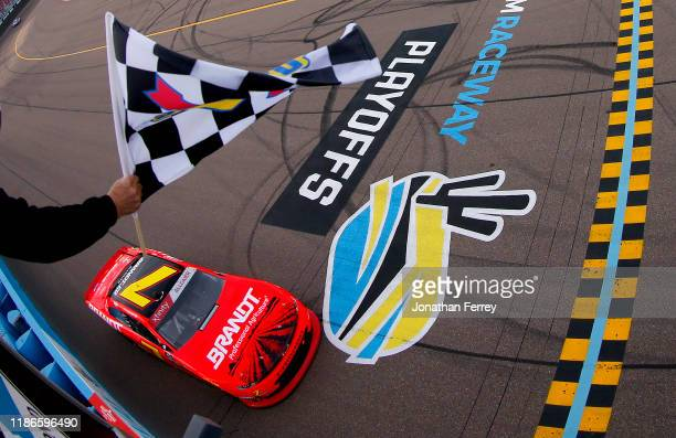 Justin Allgaier, driver of the BRANDT Professional Agriculture Chevrolet, takes the checkered flag to win the NASCAR Xfinity Series Desert Diamond...