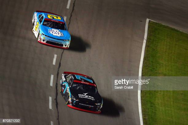 Justin Allgaier driver of the Degree Deodorant Chevrolet leads Daniel Hemric driver of the Blue Gate Bank Chevrolet during the NASCAR XFINITY Series...