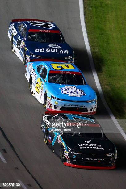Justin Allgaier driver of the Degree Deodorant Chevrolet leads Daniel Hemric driver of the Blue Gate Bank Chevrolet and Brennan Poole driver of the...