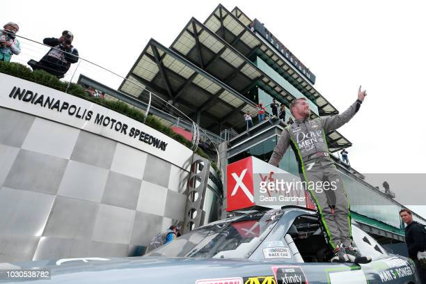 Justin Allgaier driver of the Dove Men Care Chevrolet celebrates in victory lane after winning the NASCAR Xfinity Series Lilly Diabetes 250 at...