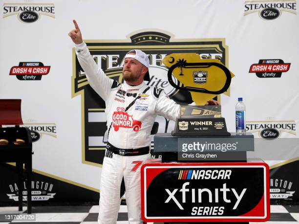 Justin Allgaier, driver of the Good Humor Ice Cream Chevrolet, celebrates in victory lane after winning the NASCAR Xfinity Series Steakhouse Elite...