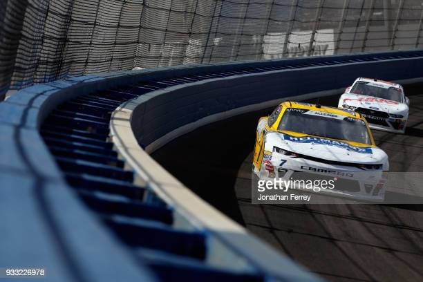 Justin Allgaier driver of the Hellmann's Chevrolet leads Cole Custer driver of the Haas Automation Ford during the NASCAR Xfinity Series Roseanne 300...