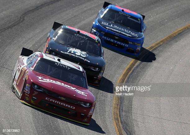 Justin Allgaier driver of the TaxSlayercom Chevrolet leads a pack of cars during the NASCAR XFINITY Series Heads Up Georgia 250 at Atlanta Motor...