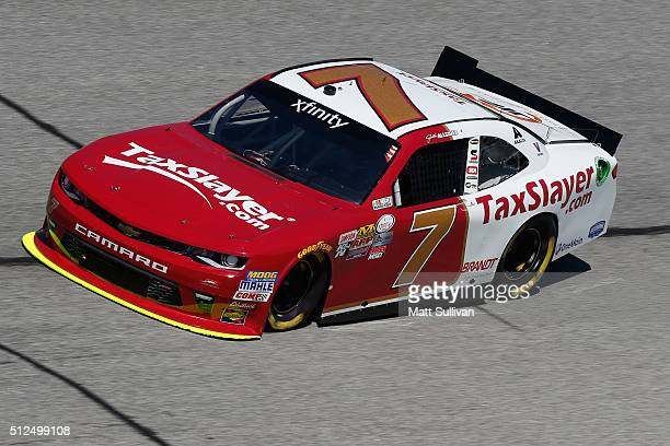 Justin Allgaier driver of the TaxSlayercom Chevrolet practices for the NASCAR XFINITY Series Heads Up Georgia 250 at Atlanta Motor Speedway on...