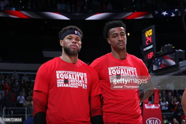Justin Anderson and John Collins of the Atlanta Hawks stand for the National Anthem before the game against the Charlotte Hornets on February 9 2019...