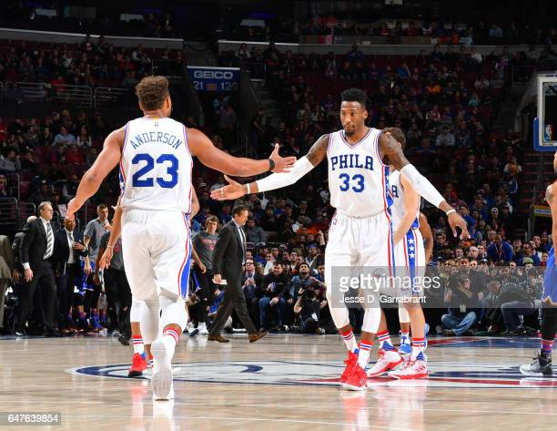 Justin Anderson and Robert Covington of the Philadelphia 76ers shake hands after Anderson's dunk against the New York Knicks at Wells Fargo Center on...