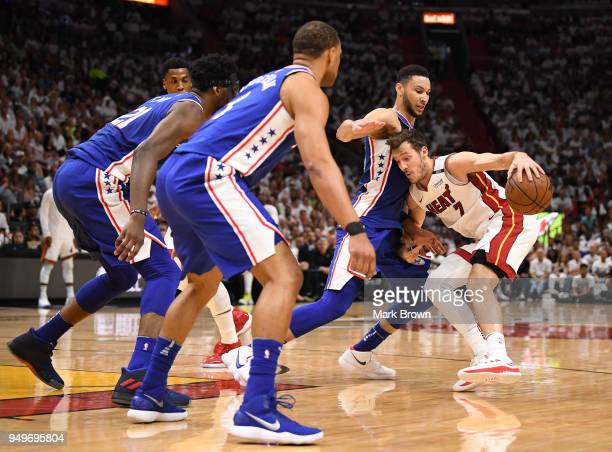 Justin Anderson Joel Embiid and Ben Simmons of the Philadelphia 76ers guard Goran Dragic of the Miami Heat in the third quarter during Game Four of...