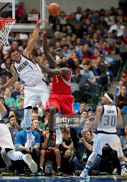 Justin Anderson of the Dallas Mavericks blocks a shot against Montrezl Harrell of the Houston Rockets in the second half at American Airlines Center...