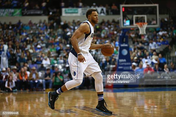 Justin Anderson of the Dallas Mavericks dribbles the ball against the San Antonio Spurs at American Airlines Center on April 13 2016 in Dallas Texas...