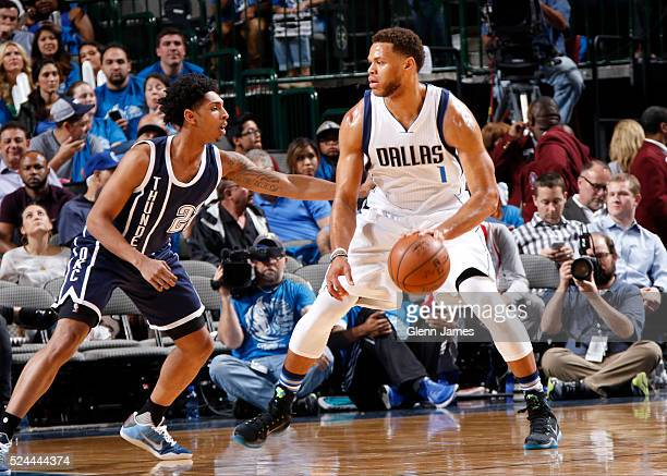 Justin Anderson of the Dallas Mavericks dribbles the ball while guarded by Cameron Payne of the Oklahoma City Thunder in Game Three of the Western...