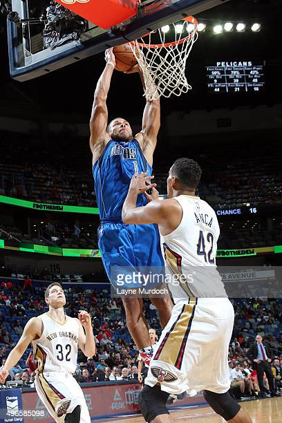 Justin Anderson of the Dallas Mavericks dunks against Alexis Ajinca of the New Orleans Pelicans during the game on November 10 2015 at Smoothie King...