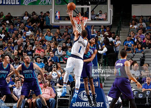 Justin Anderson of the Dallas Mavericks goes in for the lay up against the Charlotte Hornets on October 3 2016 at the American Airlines Center in...