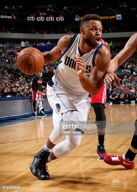 Justin Anderson of the Dallas Mavericks handles the ball against the Houston Rockets during a preseason game on October 19 2016 at the American...