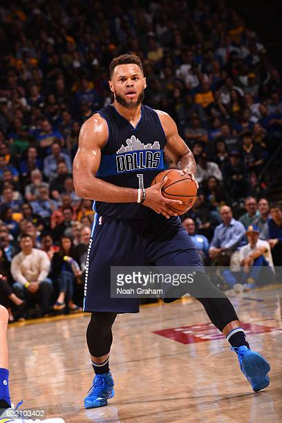 Justin Anderson of the Dallas Mavericks handles the ball against the Golden State Warriors on November 9 2016 at ORACLE Arena in Oakland California...