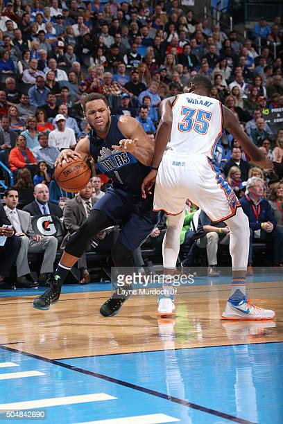 Justin Anderson of the Dallas Mavericks handles the ball during the game against Kevin Durant of the Oklahoma City Thunder on January 13 2016 at the...