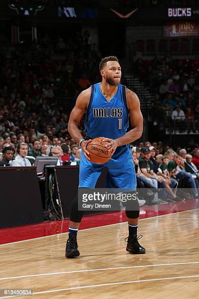 Justin Anderson of the Dallas Mavericks looks to pass the ball during a preseason game against the Milwaukee Bucks on October 8 2016 at the Kohl...