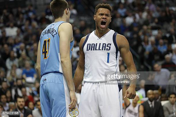 Justin Anderson of the Dallas Mavericks reacts in front of Juancho Hernangomez of the Denver Nuggets at American Airlines Center on December 12 2016...