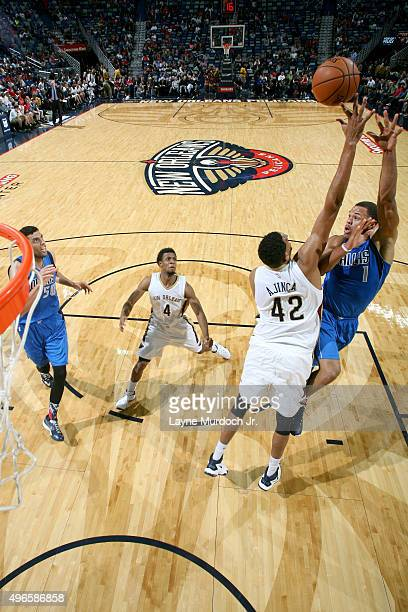 Justin Anderson of the Dallas Mavericks shoots against Alexis Ajinca of the New Orleans Pelicans during an NBA game on November 10 2015 at the...