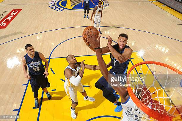 Justin Anderson of the Dallas Mavericks shoots the ball against the Golden State Warriors on November 9 2016 at ORACLE Arena in Oakland California...