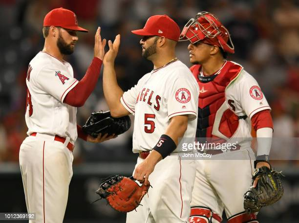 Justin Anderson of the Los Angeles Angels of Anaheim congratulates Albert Pujols and Jose Briceno after defeating the Detroit Tigers 62 at Angel...