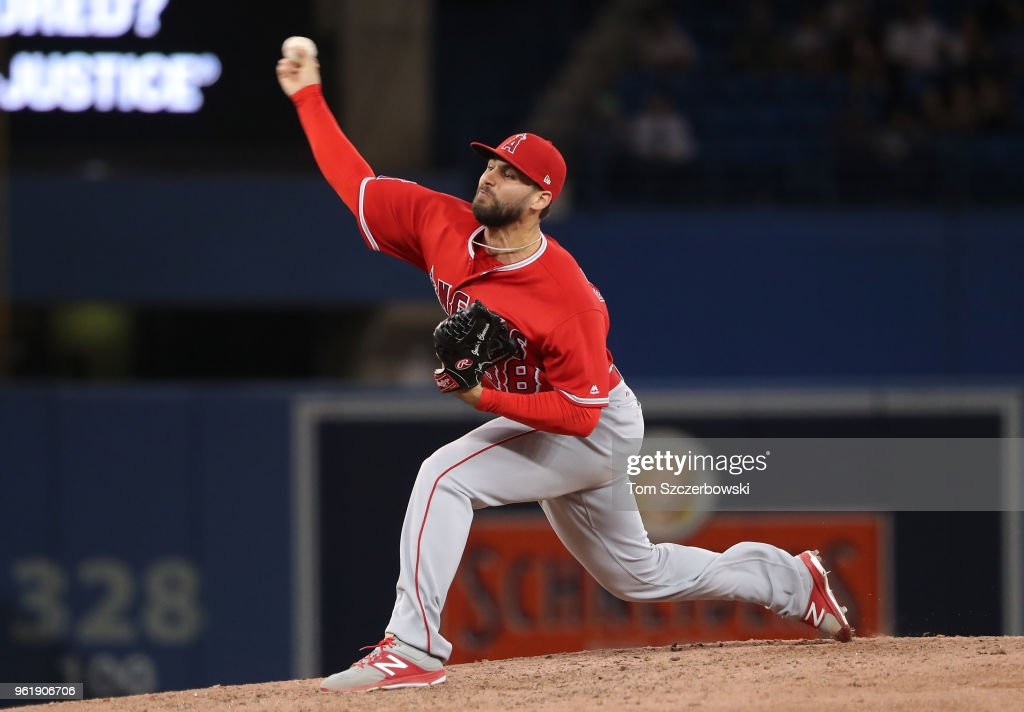 Justin Anderson #38 of the Los Angeles Angels of Anaheim delivers a pitch in the eighth inning during MLB game action against the Toronto Blue Jays at Rogers Centre on May 23, 2018 in Toronto, Canada.