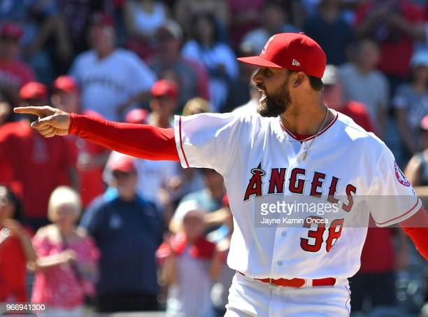 Justin Anderson of the Los Angeles Angels of Anaheim reacts after ball four was called on Joey Gallo of the Texas Rangers in the ninth inning of the...