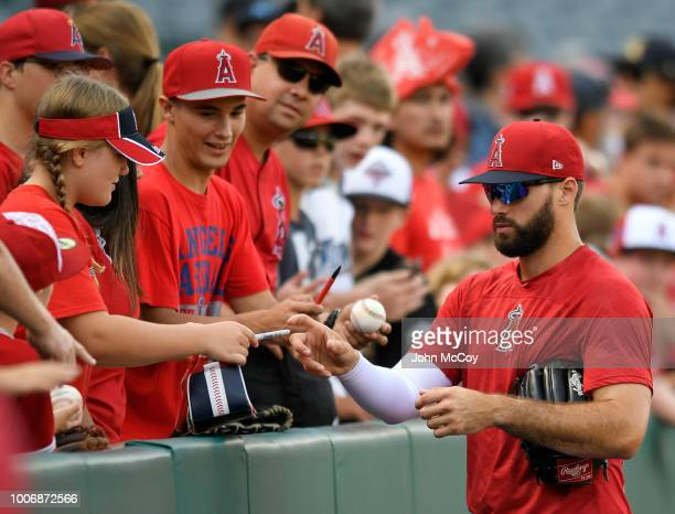 Justin Anderson of the Los Angeles Angels of Anaheim signs autographs before playing the Seattle Mariners at Angel Stadium on July 28 2018 in Anaheim...