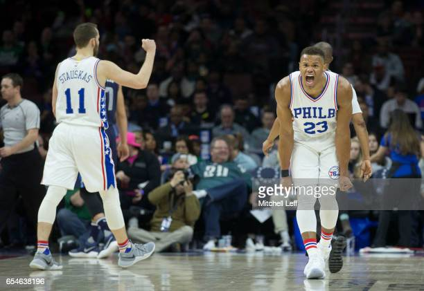 Justin Anderson of the Philadelphia 76ers and Nik Stauskas of the Philadelphia 76ers react against the Dallas Mavericks at the Wells Fargo Center on...