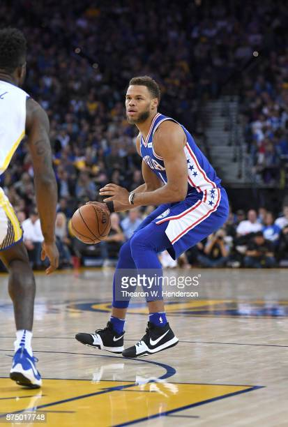 Justin Anderson of the Philadelphia 76ers dribbles the ball against the Golden State Warriors during an NBA basketball game at ORACLE Arena on...