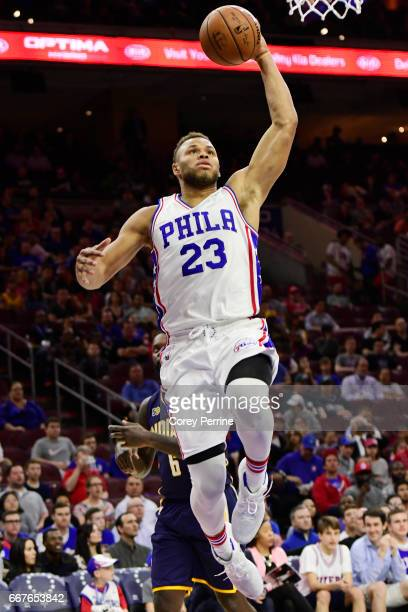 Justin Anderson of the Philadelphia 76ers drives to the basket after a whistle blown while taking on the Indiana Pacers during the first quarter at...