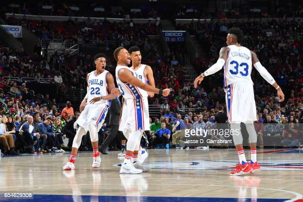 Justin Anderson of the Philadelphia 76ers gets the crowd pumped up against the Dallas Mavericks at Wells Fargo Center on March 17 2017 in...