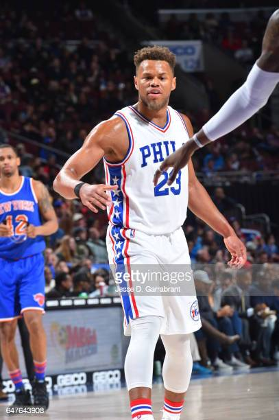 Justin Anderson of the Philadelphia 76ers shakes hands with his teammates against the New York Knicks at Wells Fargo Center on March 3 2017 in...