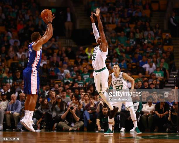 Justin Anderson of the Philadelphia 76ers shoots over Marcus Smart of the Boston Celtics during the game at TD Garden on October 9 2017 in Boston...