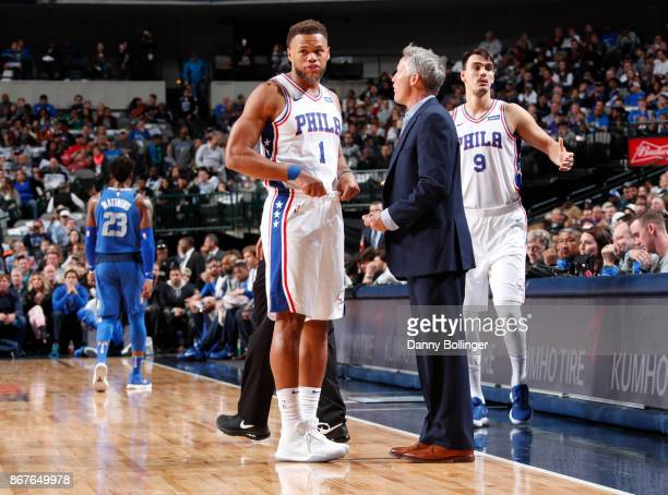 Justin Anderson of the Philadelphia 76ers speaks with head coach Brett Brown of the Philadelphia 76ers during the game against the Dallas Mavericks...