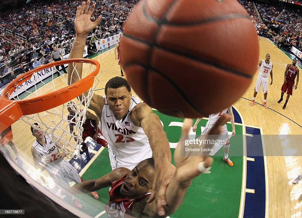 Justin Anderson #23 of the Virginia Cavaliers tries to block Lorenzo Brown #2 of the North Carolina State Wolfpack during the quarterfinals of the Men's ACC Basketball Tournament at Greensboro Coliseum on March 15, 2013 in Greensboro, North Carolina.