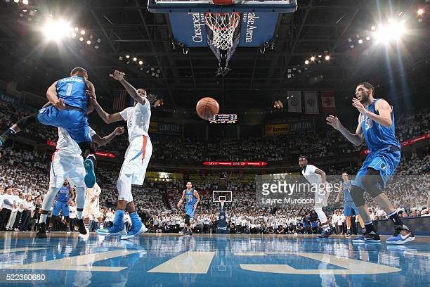Justin Anderson passes the ball to Salah Mejri of the Dallas Mavericks against the Oklahoma City Thunder in Game Two of Western Conference...