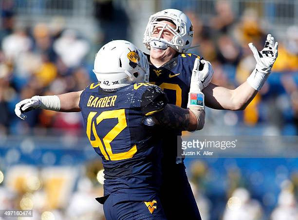 Justin Arndt of the West Virginia Mountaineers celebrates after recovering a fumble on a kick return in the second half during the game against the...