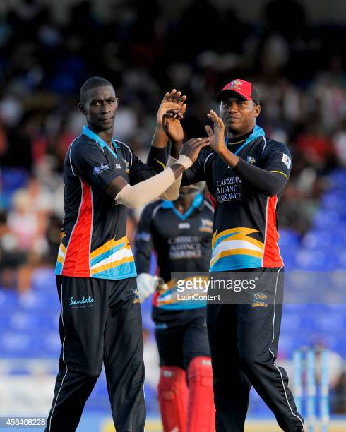 Justin Athanaze and Marlon Samuels of Antigua Hawksbills celebrate the dismissal of Evin Lewis of The Trinidad and Tobago Red Steel during a match...