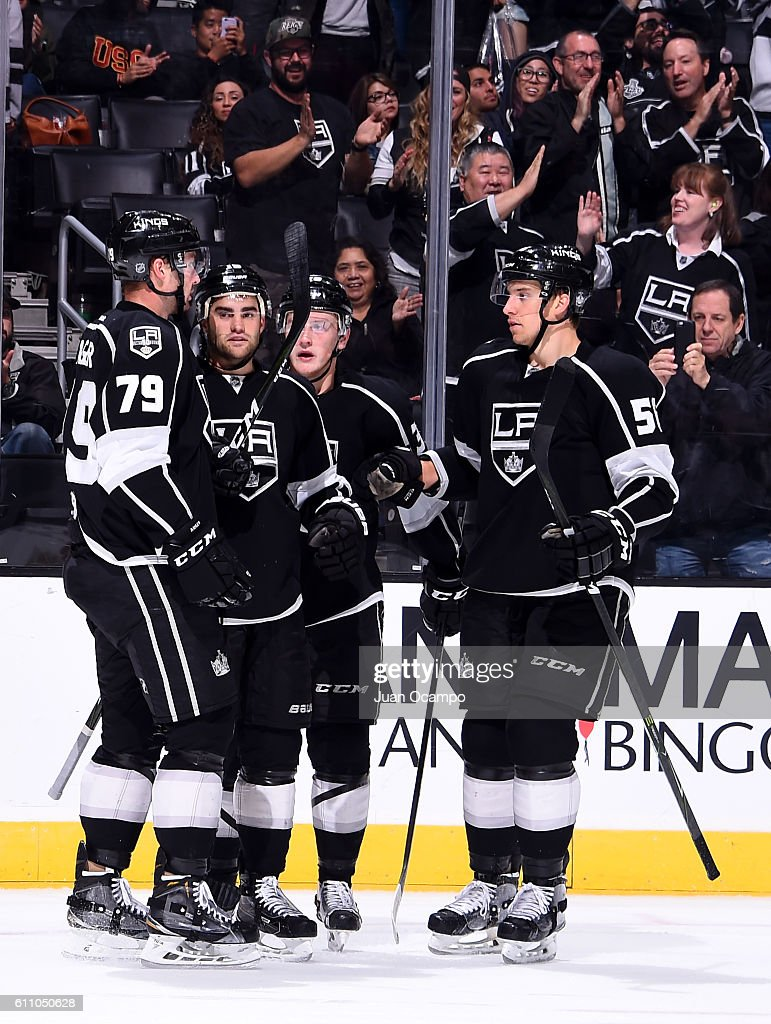 Justin Auger #79, Andy Andreoff #15, Adrian Kempe #39 and Kurtis McDermid #56 of the Los Angeles Kings celebrate Andreoff's third period goal against the Anaheim Ducks on September 28, 2016 at STAPLES Center in Los Angeles, California.