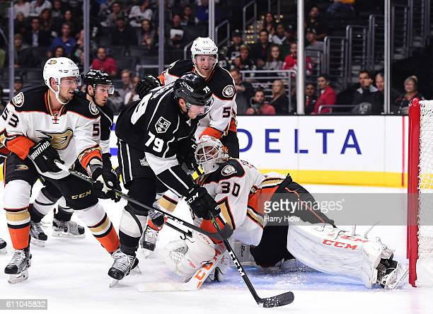 Justin Auger of the Los Angeles Kings scores on Dustin Tokarski of the Anaheim Ducks to take a 30 lead as Shea Theodore and Jeff Schultz look on...