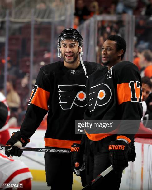 Justin Bailey and Wayne Simmonds of the Philadelphia Flyers talk during warm ups before the game against the Detroit Red Wings at Wells Fargo Center...