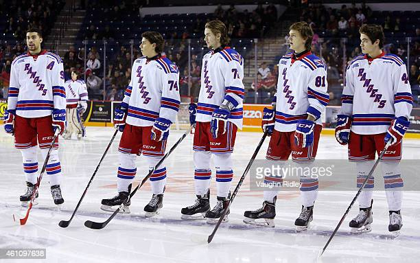 Justin Bailey Connor Bunnaman Ryan MacInnis Dmitrii Sergeev and Frank Hora of the Kitchener Rangers stand for the national anthem prior to an OHL...