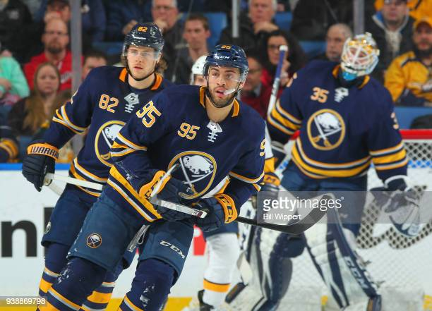 Justin Bailey Nathan Beaulieu and Linus Ullmark of the Buffalo Sabres skate during an NHL game against the Nashville Predators on March 19 2018 at...