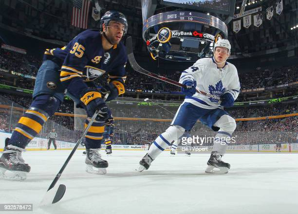 Justin Bailey of the Buffalo Sabres and Kasperi Kapanen of the Toronto Maple Leafs of the Toronto Maple Leafs follow the play during an NHL game on...