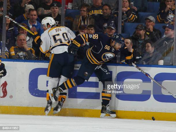 Justin Bailey of the Buffalo Sabres avoids a check from Roman Josi of the Nashville Predators during an NHL game at the KeyBank Center on February 28...