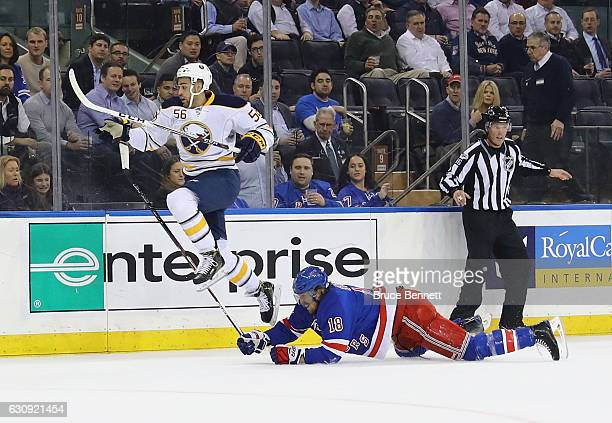 Justin Bailey of the Buffalo Sabres gets past Marc Staal of the New York Rangers during the first period at Madison Square Garden on January 3 2017...