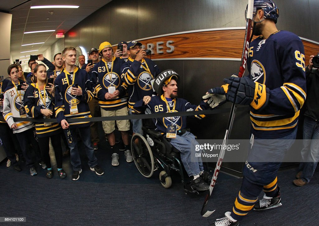 Justin Bailey #95 of the Buffalo Sabres greets fans as he heads to the ice during an NHL game against the Vancouver Canucks on October 20, 2017 at KeyBank Center in Buffalo, New York.