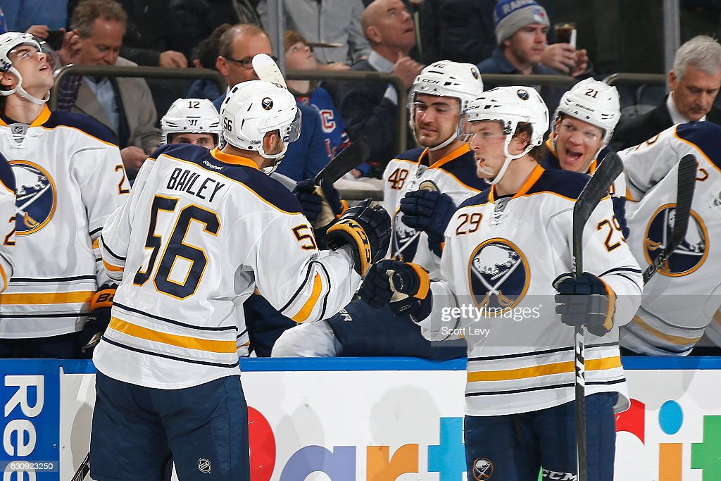 Justin Bailey #56 of the Buffalo Sabres is congratulated by his teammate Jake McCabe #29 after scoring his first career goal against the New York Rangers during the second period at Madison Square Garden on January 3, 2017 in New York City.