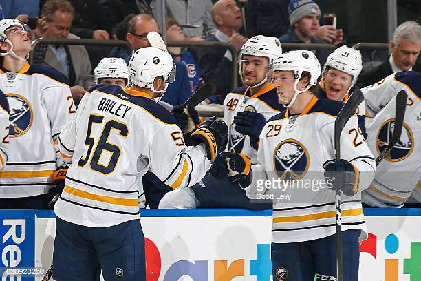 Justin Bailey of the Buffalo Sabres is congratulated by his teammate Jake McCabe after scoring his first career goal against the New York Rangers...